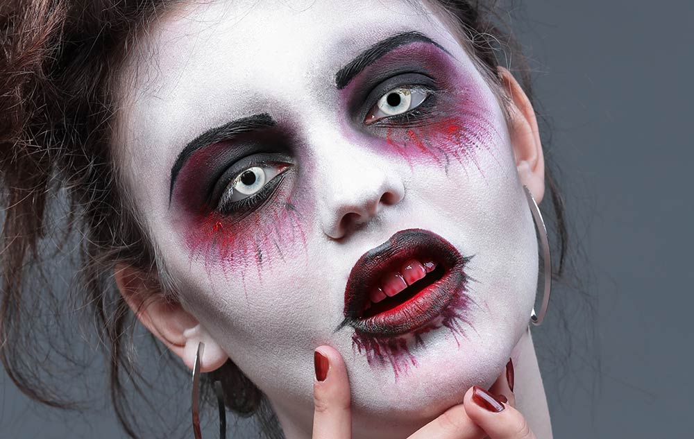 Scary girl wearing contact lenses for halloween