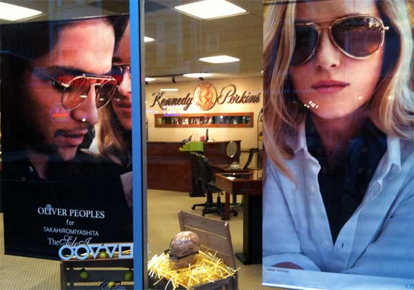 Posters of the latest sunglasses styles at the Kennedy & Perkins office