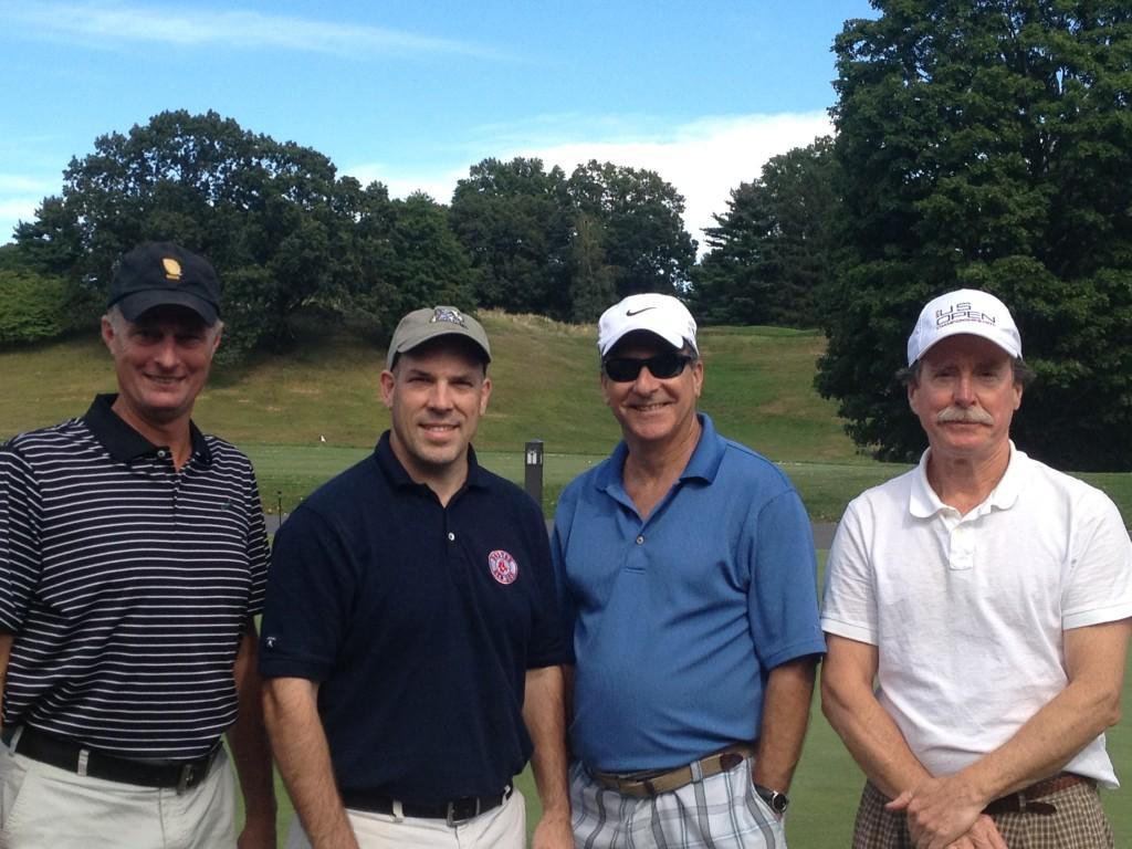 Rick Kennedy and Dart Messick playing golf