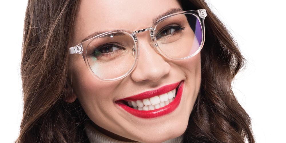 Smiling woman wearing eyeglasses from Kennedy & Perkins